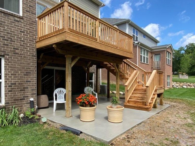 Deck with stairs for 2-story brick home in Michigan