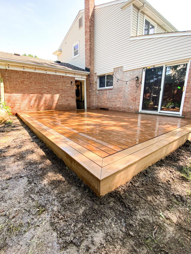 Classic Picture Frame Composite Deck on Brick Home by Michigan Deck Builders