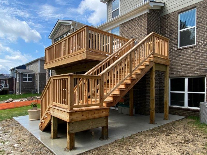 Custom Composite Deck with Long Staircase and railings for 2-Level Michigan Home