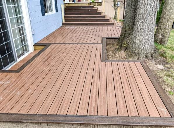 Classic Picture Frame Composite Deck built around trees for Michigan home