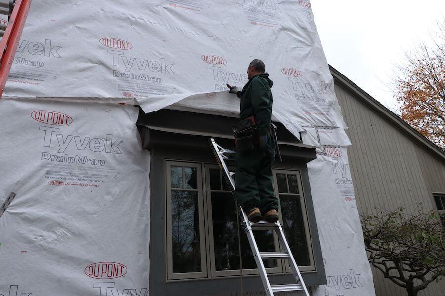 Worker preparing to Install Hardie siding