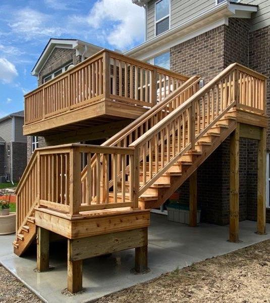 second story composite deck with stairs to patio