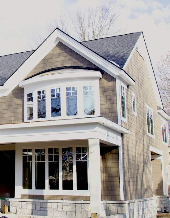 home construction with James Hardie siding in dark taupe