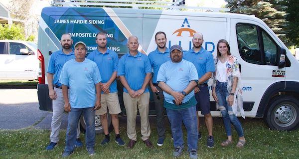 allied's team in front of service van