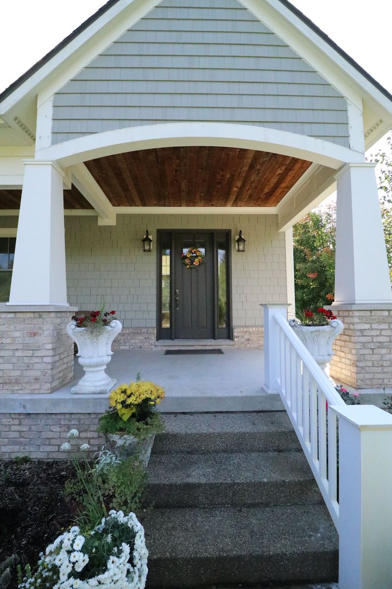 front porch of home with James Hardie Shingles in taupe color