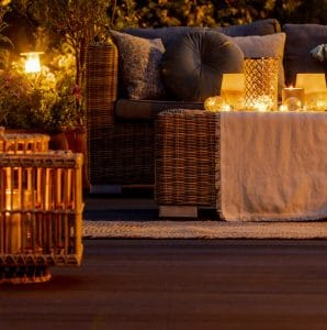 deck with candles and furniture for mood lighting for party on deck in Michigan