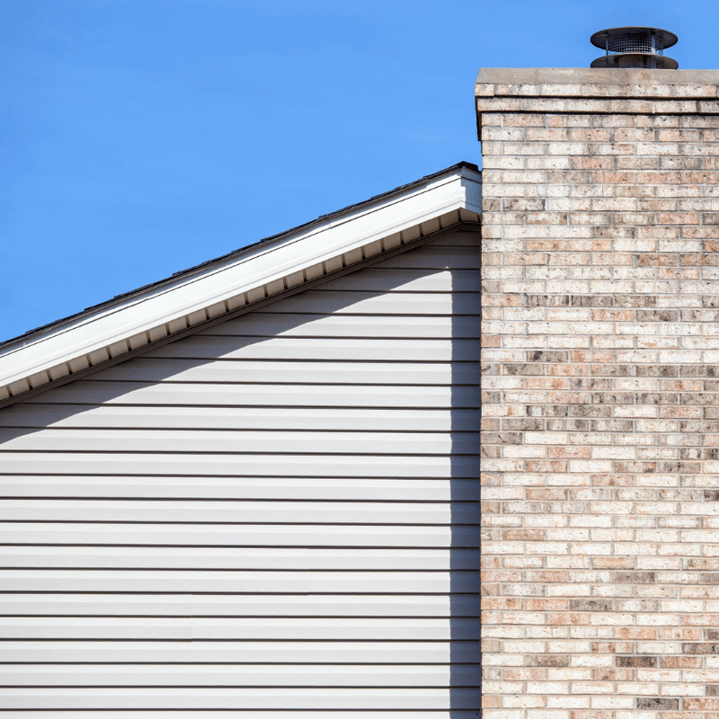 vinyl siding on home with chimney