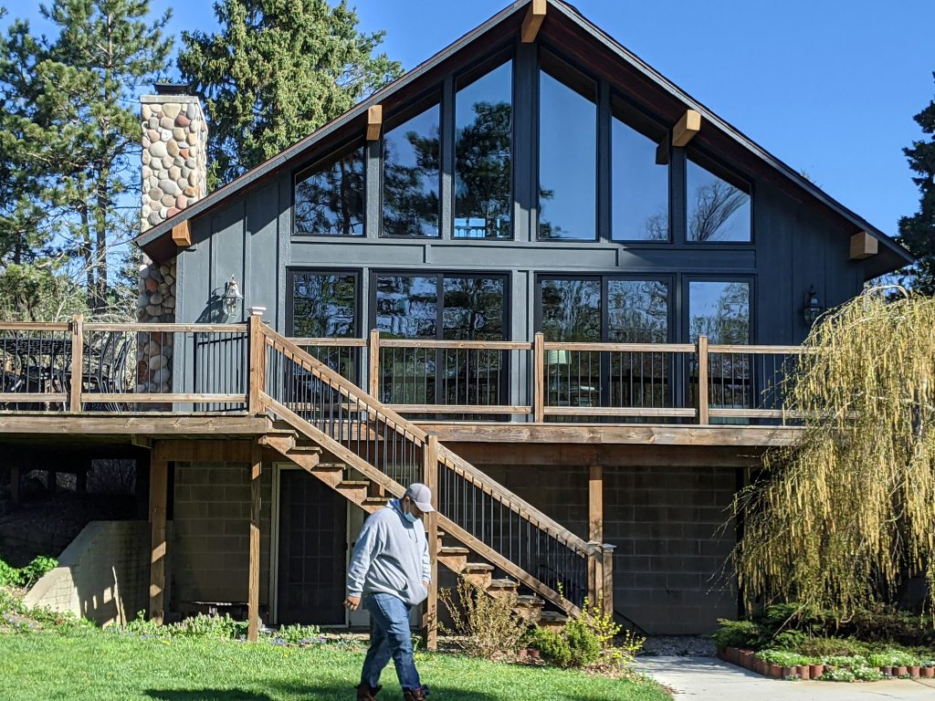 home with large windows and slate siding from siding and window remodel in Michigan with recommended James Hardie siding